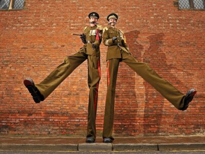 Army Major stilt walkers in the city of York by Jonathan Pow.