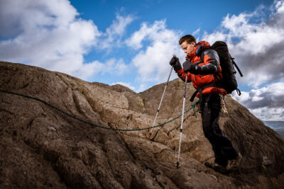 COMMERCIAL PHOTOGRAPHER - A photograph of a climbing model ascending in a down jacket