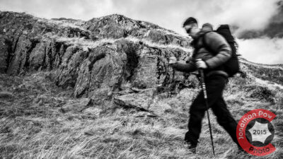 COMMERCIAL PHOTOGRAPHER - A model hill walking across the photograph in black and white